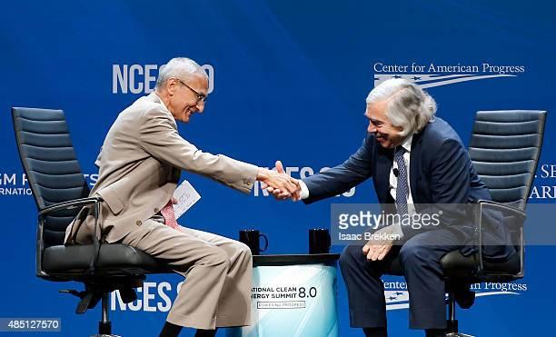 Former counselor to President Barack Obama John Podesta and US Secretary of Energy Ernest Moniz shake hands during the National Clean Energy Summit...