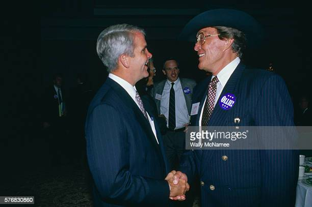 Former countrywestern singer now turned entrepreneur in the food business Jimmy Dean shakes hands with Oliver North at a fundraising event in...