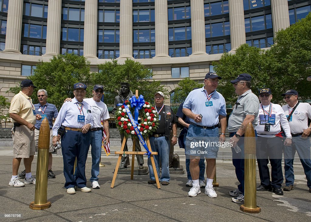 Former crew members of the USS Springfield gather for a group photo at the conclusion of the memorial service in honor of the ship at the Navy Memorial in Washington on Friday, May 22, 2009. Over eighty former crew members are in DC for a week or reunion activities.