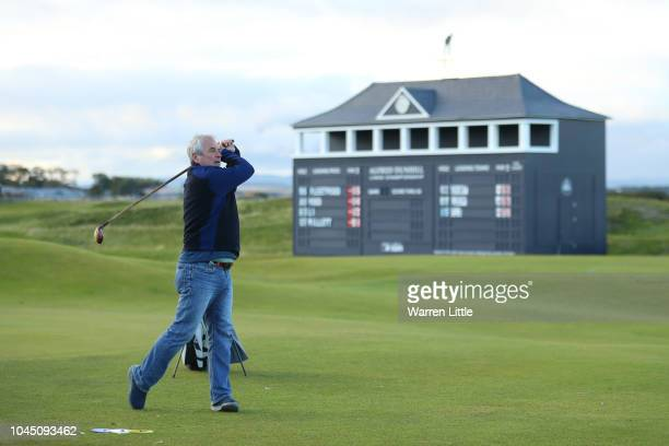 Former cricket player Allan Lamb plays the Hickory challenge on the 18th green during previews prior to the 2018 Alfred Dunhill Links Championship at...