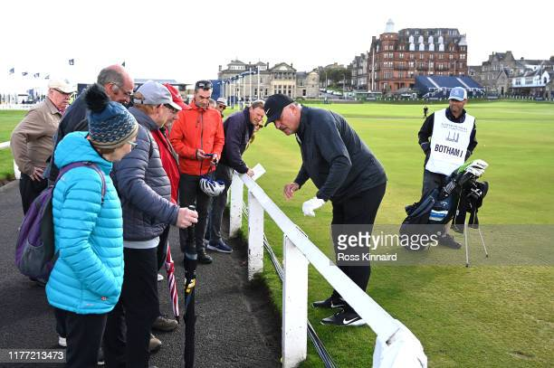 Former Cricket player, Sir Ian Botham looks for his ball on the 1st hole during Day one of the Alfred Dunhill Links Championship at The Old Course on...