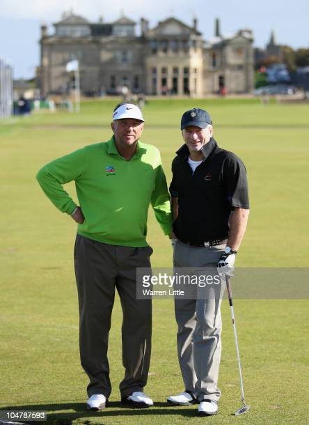 Former cricket stars Ian Botham of England and Steve Waugh of Australia pose for a picture on the first fairway during the second practice round of...