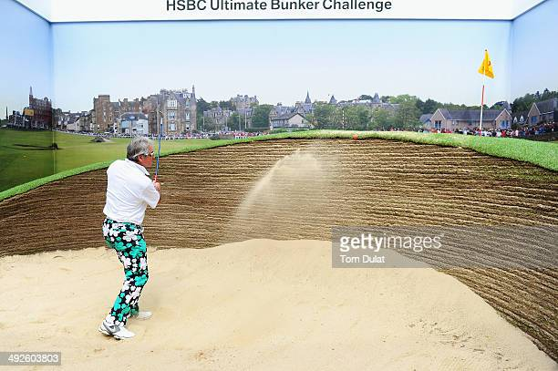 Former Cricketer Allan Lamb takes part in the HSBC Celebrity Challenge at a replica of the Road Hole Bunker St Andrews ahead of the BMW PGA...