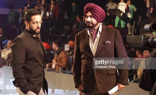 Former cricketer and BJP leader Navjot Singh Sidhu acts as a presenter during the Pro Wrestling League at Guru Nanak Dev Stadium on December 14 2015...