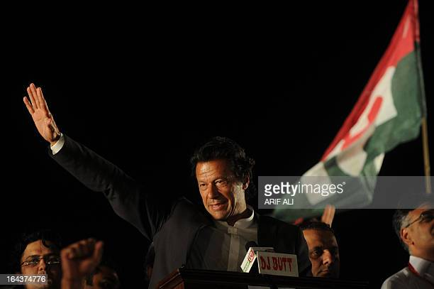 Former cricketer and chairman of Pakistan's political party Pakistan TehreekeInsaf Imran Khan gestures as he addressing a public meeting in Lahore on...