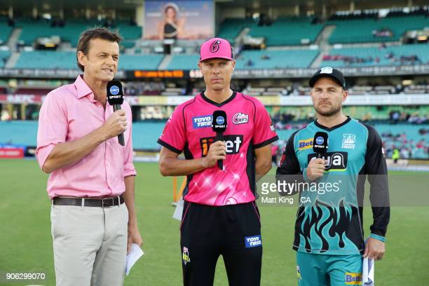 Former cricketer and commentator Adam Gilchrist speaks on camera to captains Brendon McCullum of the Heat and Johan Botha of the Sixers during the...