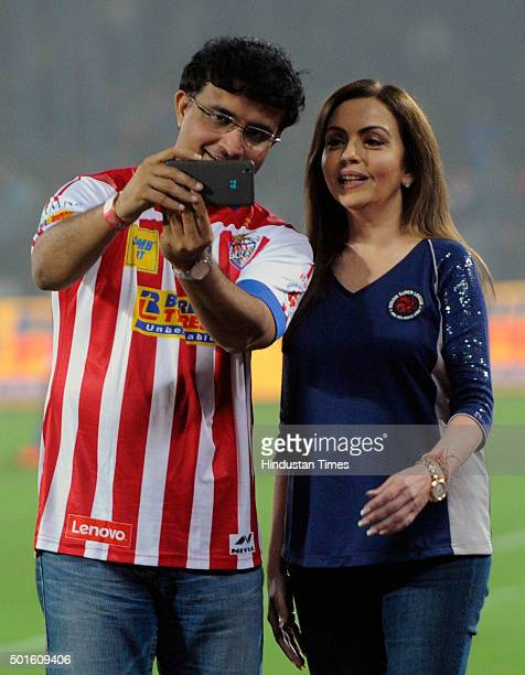 Former cricketer and coowner of Atletico de Kolkata Sourav Ganguly clicks a selfie with Nita Ambani during the ISL semifinal second leg match between...