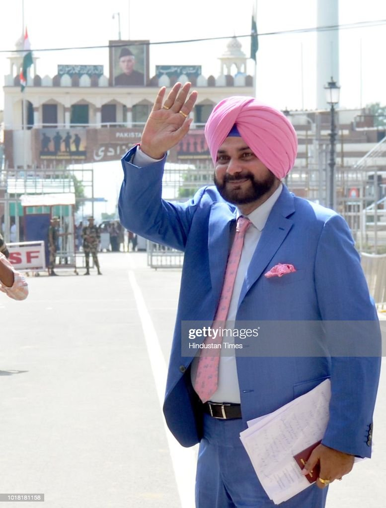 Former Cricketer And Punjab Local Bodies Minister Navjot Singh Sidhu bids goodbye as he crosses over to Pakistan at AttariWagah Border on August 17...