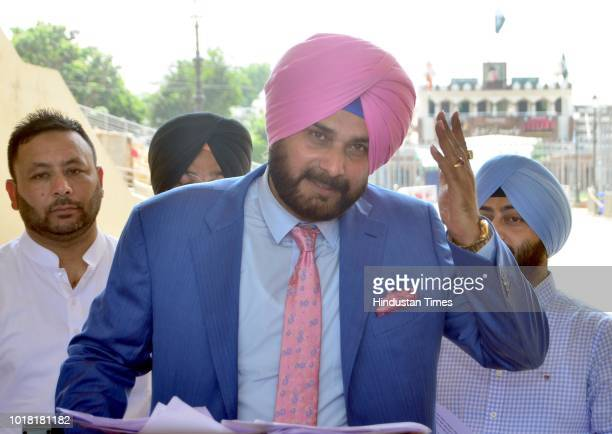 Former Cricketer And Punjab Local Bodies Minister Navjot Singh Sidhu addresses media personnel before crossing over to Pakistan at AttariWagah Border...