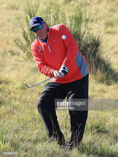 Former cricketer Ian Botham plays a shot during a practice round ahead of The Alfred Dunhill Links Championship at Kingsbarns on September 29, 2021...