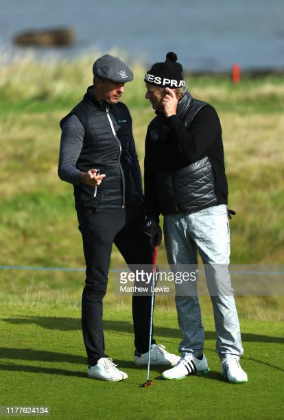 Former Cricketer Michael Vaughan speaks with Actor Bill Murray on the 3rd hole during Day three of the Alfred Dunhill Links Championship at...