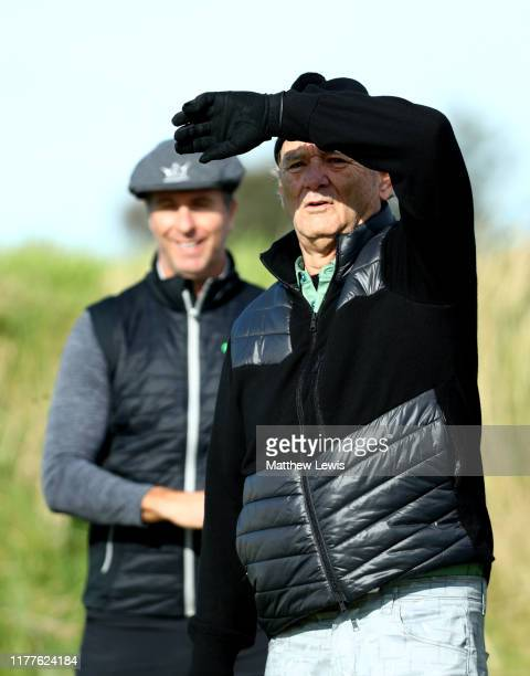 Former Cricketer Michael Vaughan watches Actor Bill Murray on the 3rd hole during Day three of the Alfred Dunhill Links Championship at Kingsbarns...