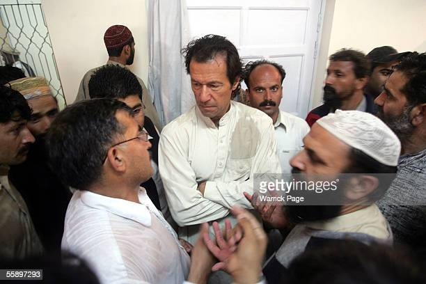 Former cricketer now Paksitani politician, Imran Khan meets Balakot earthquake victims at makeshift hospital October 11, 2005 in Mansehra, Pakistan....