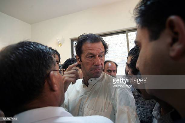 Former cricketer now Paksitani politician Imran Khan meets Balakot earthquake victims at makeshift hospital October 11 2005 in Mansehra Pakistan...