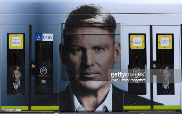 Former cricketer Shane Warne pictured on the side of a tram in the city advertising a fragrance SW23 near the Melbourne Cricket Ground on January 01,...