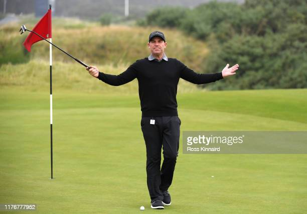 Former Cricketer, Shane Warne reacts during previews for the Alfred Dunhill Links Championship at Kingsbarns on September 24, 2019 in St Andrews,...