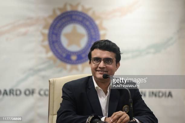 Former cricketer Sourav Ganguly and newly-elected president of the Board of Control for Cricket in India smiles during a press conference at the BCCI...