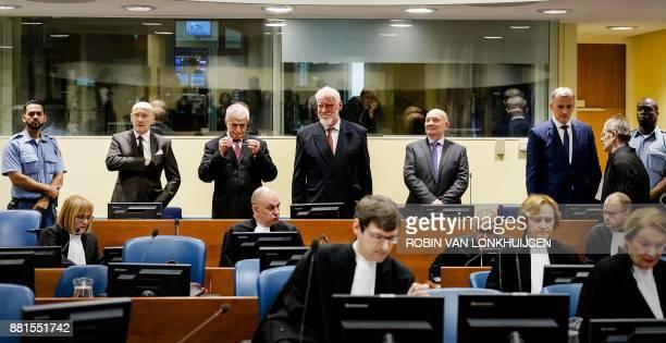 TOPSHOT Former Croatian Prime Minister Jadranko Prlic former Bosnian Croat Defense Minister Bruno Stojic former Croatian general Slobodan Praljak...