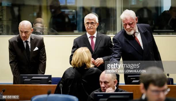 Former Croatian Prime Minister Jadranko Prlic former Bosnian Croat Defense Minister Bruno Stojic and former Croatian general Slobodan Praljak are...