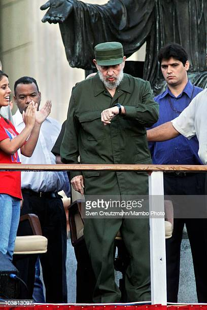 Former Cuban leader Fidel Castro looks at his watch as he waits to deliver a speech in front of Cuban students on the stairs of the University of...