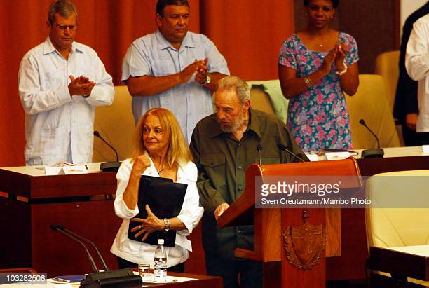 Former Cuban leader Fidel Castro talks with his wife Dalia Soto del Valle during a meeting with the delegates of the National Assembly on August 7 in...