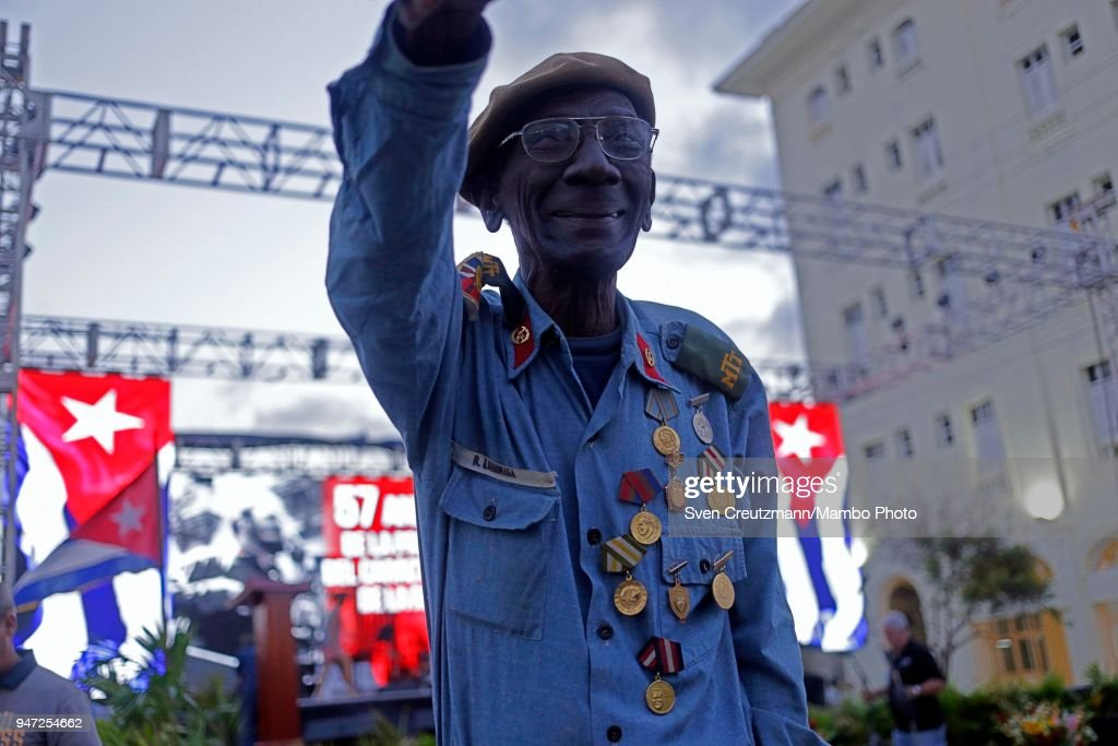 A former Cuban militia fighter raises his arm at the end of a political act commemorating the 57th anniversary of a speech in which leader Fidel Castro declared the revolution to be Socialistic, on April 16, 2018 in Havana, Cuba. The act took place at the same corner of the streets 23 and 12 in Havanas Vedado district, where Castro in 1961 attended a funeral rally after the bombing of Cuban airports that marked the begin of the Bay of Pigs invasion.