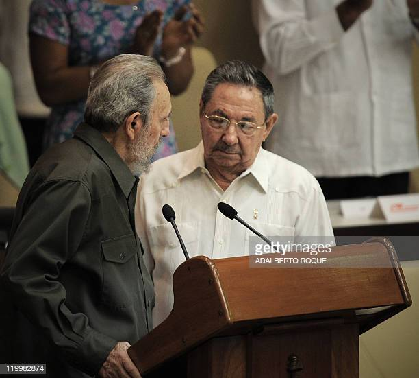 Former Cuban President Fidel Castro talks with his brother President Raul Castro during a special session of the Cuban Parliament on August 7 2010 in...