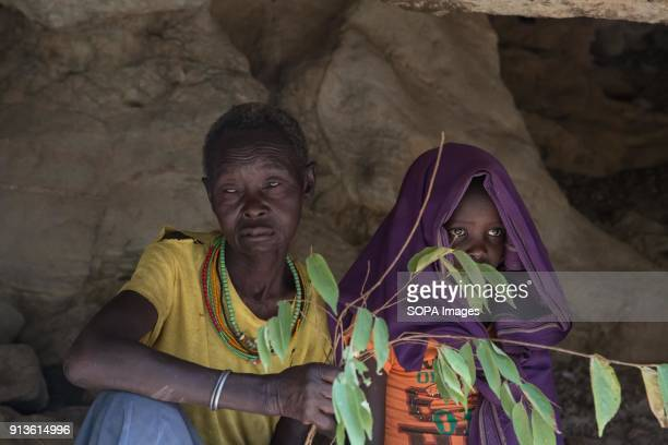 Former cutter Chepureto Lebul and a young girl from the Pokot tribe take part in a reenaction of the ceremony Pokot tribal people perform before a...