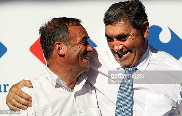 Former cycling champions Bernard Hinault and Eddy Merckx stand on stage together following stage one of the Tour de France July 4 2010 in Brussels...
