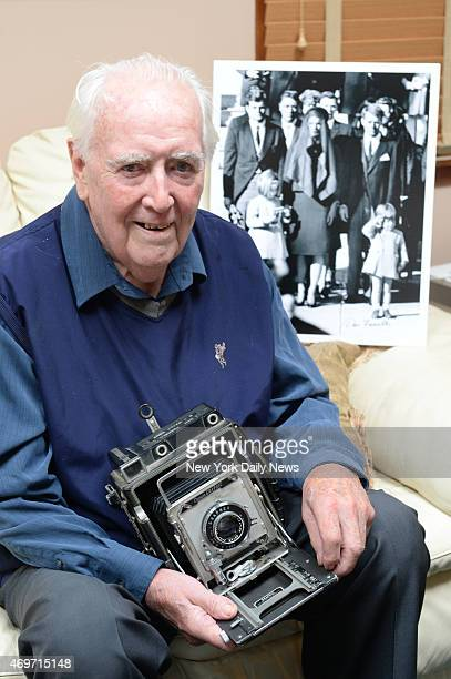 Former Daily News Photographer Dan Farrell with the prizewinning photograph he took of John F Kennedy Jr saluting at the funeral of his father...