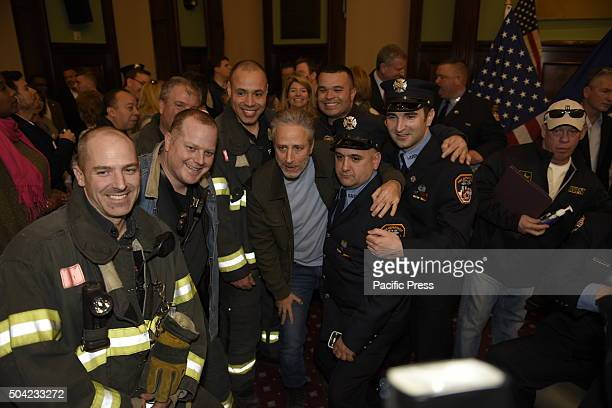 Former Daily Show host and first responder advocate Jon Stewart poses with FDNY personnel Mayor de Blasio gathered with fire fighters in city council...