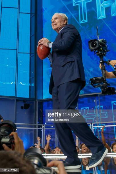 Former Dallas Cowboy Quarterback Roger Staubach throws a football into the crowd during the first round of the NFL Draft on April 26, 2018 at AT&T...
