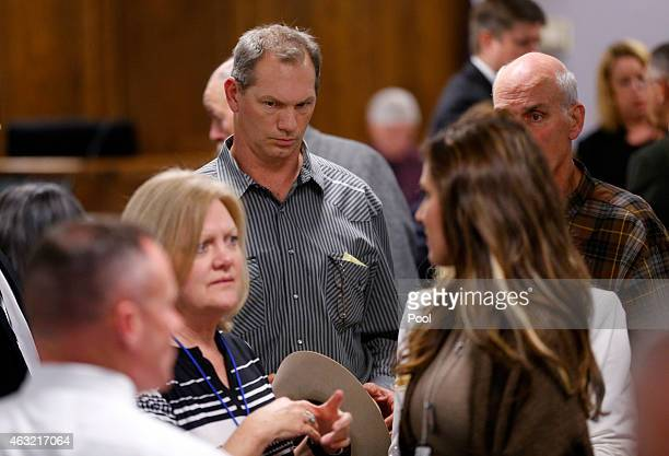 Former Dallas Cowboys football player Jay Novacek follows the Kyle family out of the courtroom after the capital murder trial of former Marine Cpl...