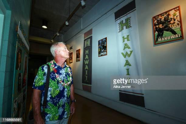 Former Dallas Cowboys great Daryl Moose Johnston walks around Aloha Stadium before the preseason game between the Dallas Cowboys and the Los Angeles...