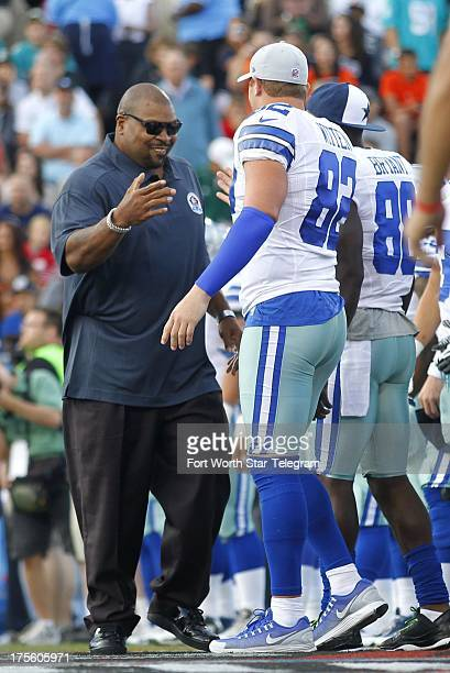 Former Dallas Cowboys lineman Larry Allen now in the Hall of Fame greets Cowboys tight end Jason Witten and wide receiver Dez Bryant before the Hall...