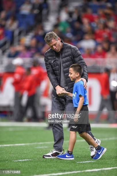 Former Dallas Cowboys quarterback Troy Aikman walks off the field after bringing in the game ball during the AAF game between the Orlando Apollos and...