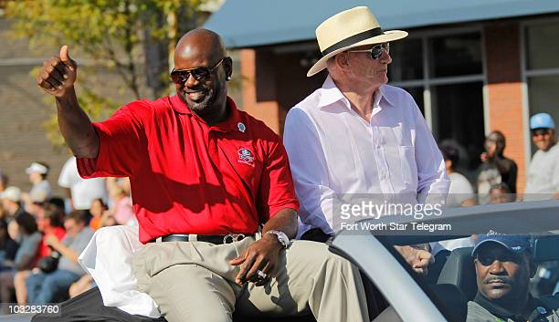Former Dallas Cowboys running back Emmitt Smith and Cowboys owner Jerry Jones right enjoy an enthusiastic crowd at the Timken Grand Parade in...