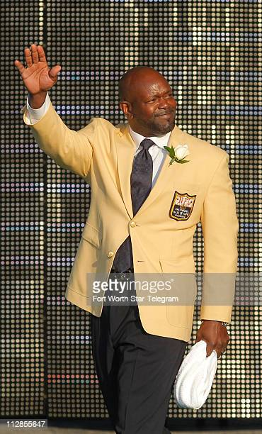 Former Dallas Cowboys running back Emmitt Smith is introduced at the Enshrinement Ceremony for the Pro Football Hall of Fame in Canton Ohio Saturday...
