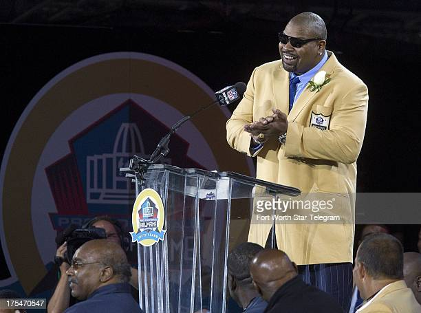 Former Dallas Cowboys star Larry Allen speaks during the Pro Football Hall of Fame 2013 Enshrinement Ceremony at Fawcett Stadium in Canton Ohio on...