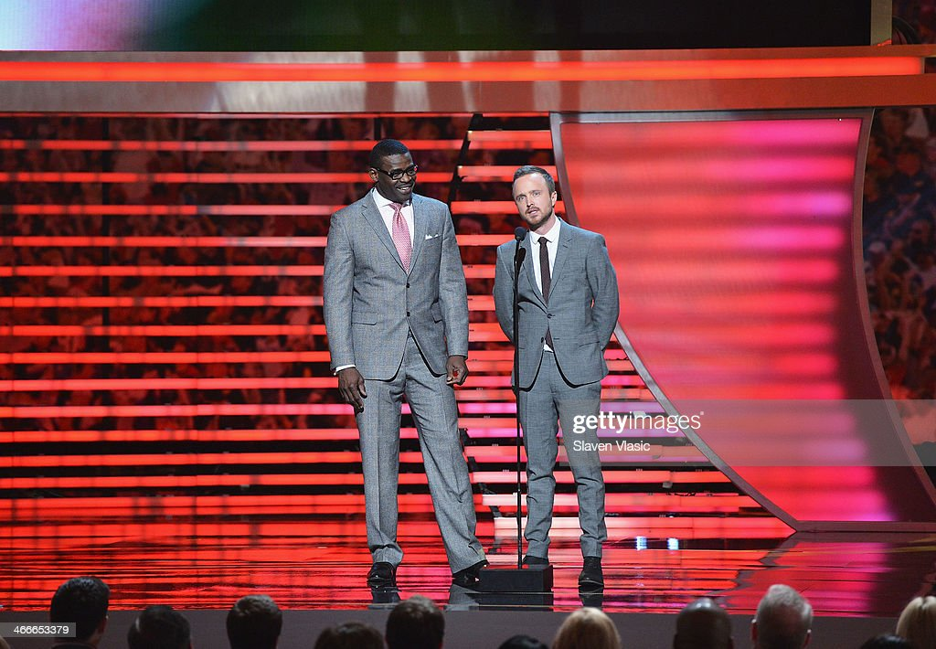 Former Dallas Cowboys wide receiver Michael Irvin (L) and actor Aaron Paul attend the 3rd Annual NFL Honors at Radio City Music Hall on February 1, 2014 in New York City.