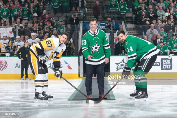 Former Dallas Star and current Pittsburgh Penguins Assistant General Manager Bill Guerin drops a ceremonial first puck between Sidney Crosby and...