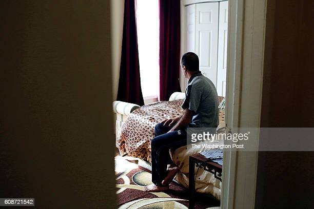 A former Damascus restaurant owner who asked to not show his face poses in his bedroom on Wednesday September 14 2016 in Aurora IL