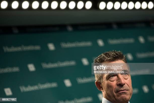 Former Danish Prime Minister and former Secretary General of NATO Anders Fogh Rasmussen listens to a question during a forum about sanctions on...