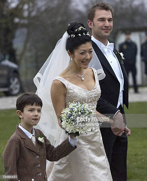 Former Danish Princess Alexandra with her son Prince Nikolai and photographer Martin Jorgensen after their wedding at Oester Egede Church 03 March...