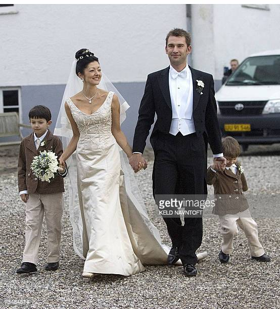 Former Danish Princess Alexandra with her sons Prince Nikolai Prince Felix and photographer Martin Jorgensen after their wedding at Oester Egede...
