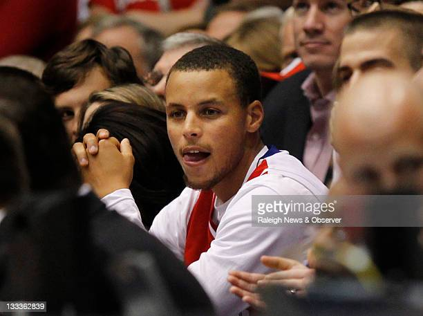 Former Davidson player Stephen Curry watches as his brother Duke guard Seth Curry play against Davidson at Cameron Indoor Stadium in Durham North...