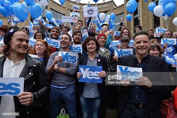 Former Deacon Blue front man Ricky Ross joins Yes Supporters as they gather on Buchanan Street during the final day of campaigning for the scottish...
