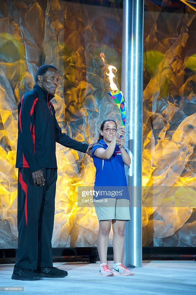 Former Decathlete/Actor Rafer Johnson receives the Flame Of Hope from Destiny Sanchez at the Opening Ceremony Of The Special Olympics World Games Los Angeles 2015 at Los Angeles Memorial Coliseum on July 25, 2015 in Los Angeles, California.