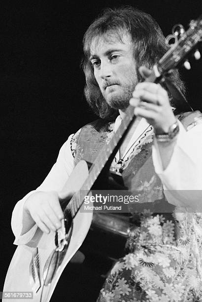Former Deep Purple bassist Roger Glover playing an acoustic guitar at a oneoff rock opera performance of his concept album 'The Butterfly Ball and...