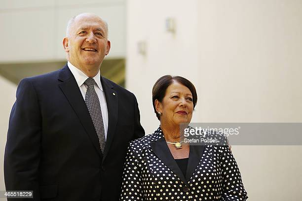 Former Defence Force chief General Peter Cosgrove poses for photographers with his wife Lynne after being announced as the next Governor General on...